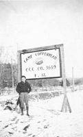 Enrollee Bob Lee at entrance to Camp Copperhead.