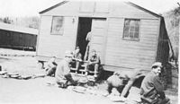 A group of Copperhead boys relaxing outside of their barracks which includes Everson, Braham, Martin and Condry.