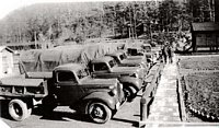 Some Camp Kanawha CCC trucks. Every CCC company was mobilized to carry out its varied conservation missions. Frequently, the boys had to travel far from camp each day to road-building and erosion control sites. These field crews were divided into work detail sections. This photo was probably taken on a weekend.