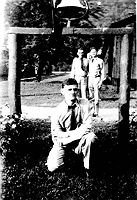 V.E. Bolyard, enrollee of Camp Parsons pictured in 1940 near the camp entrance. It seems most, if not all CCC camps had bells for routine calls and emergencies. Ibid, page 64.